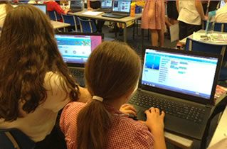 Picture of the children learning Computing